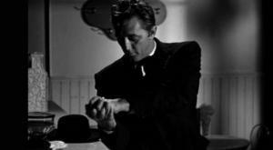 Robert Mitchum en su papel de Predicador en La noche del cazador